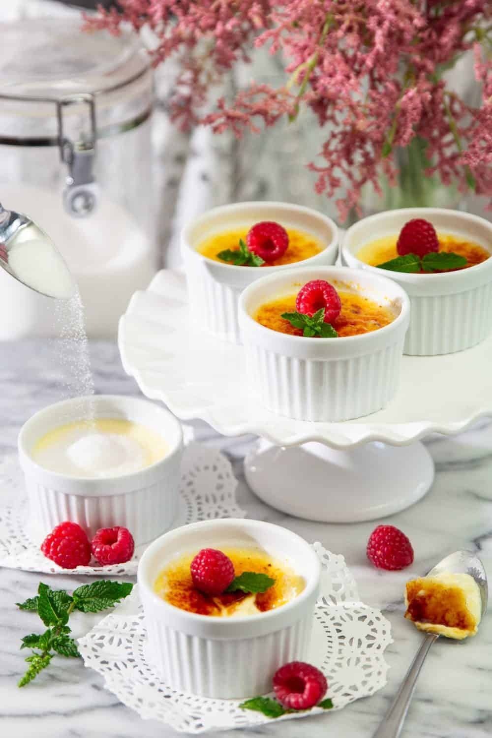 white chocolate creme brulee with raspberries and mind on top