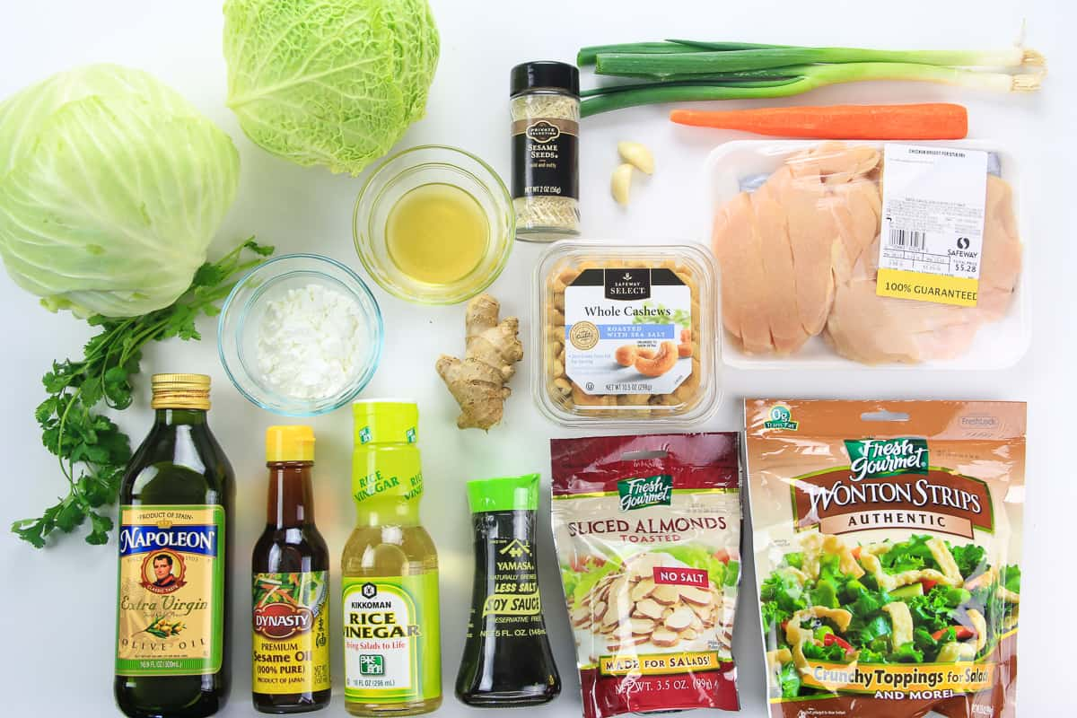 an overhead image of ingredients needed for Asian chicken salad on a white background