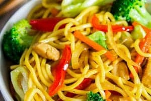 yakisoba noodles, broccoli, red bell pepper, and carrots in a bowl, chow mein