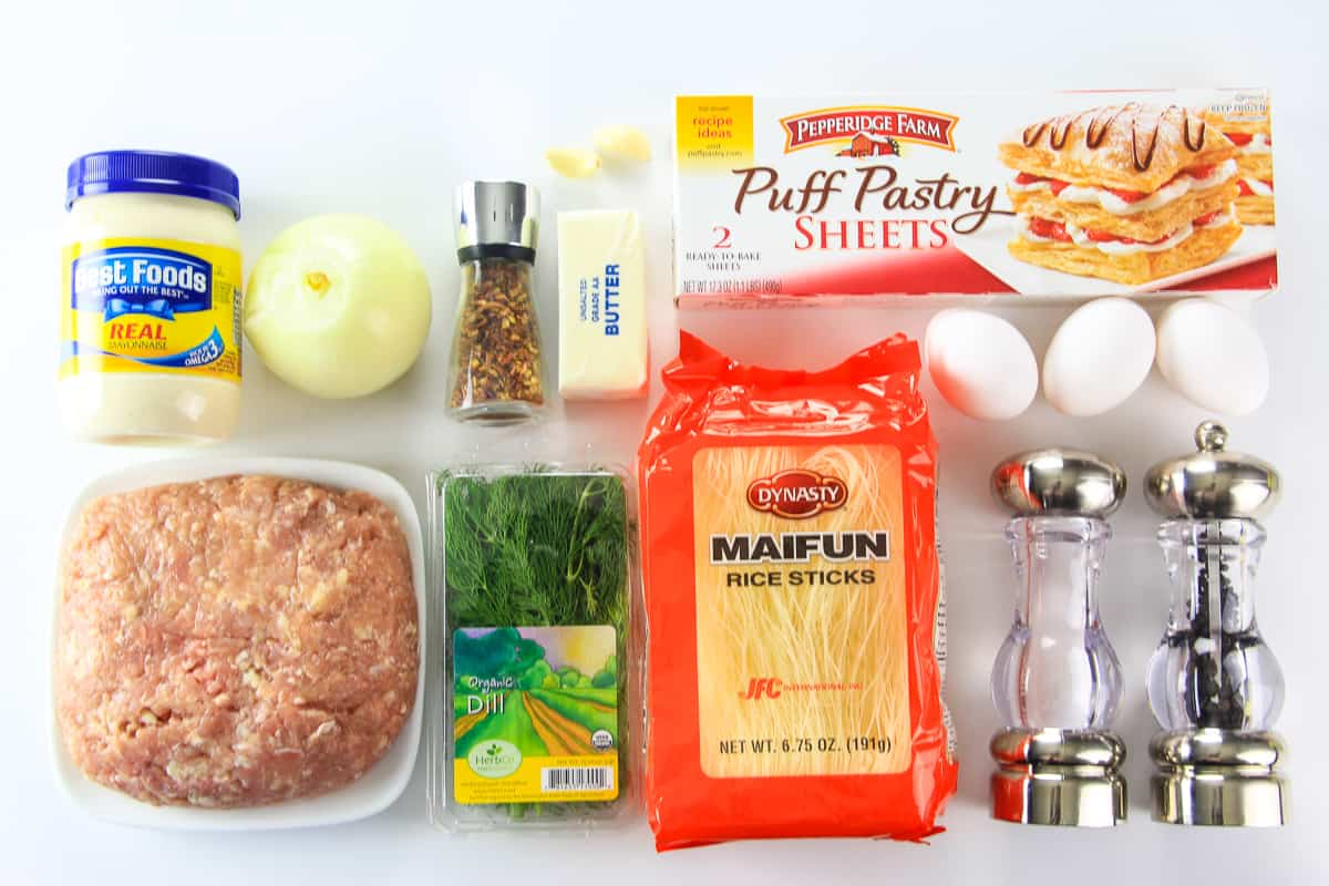 Ingredients for chicken puff pastry roll laid flat on a white surface