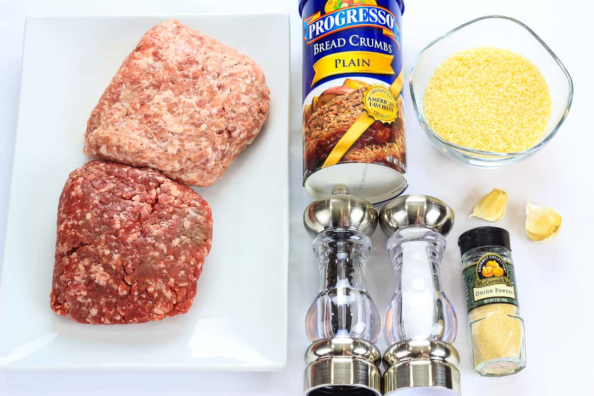 ingredients for barbecue meatballs laying on a flat white surface and photographed from overhead