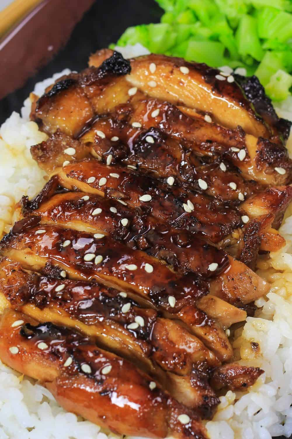 A close up of sliced teriyaki chicken.