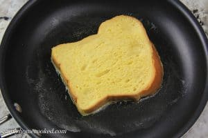 cooking a egg dredged bread on a skillet