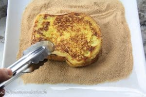 dredging french toast in sugar
