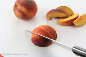 slicing peaches with a knife