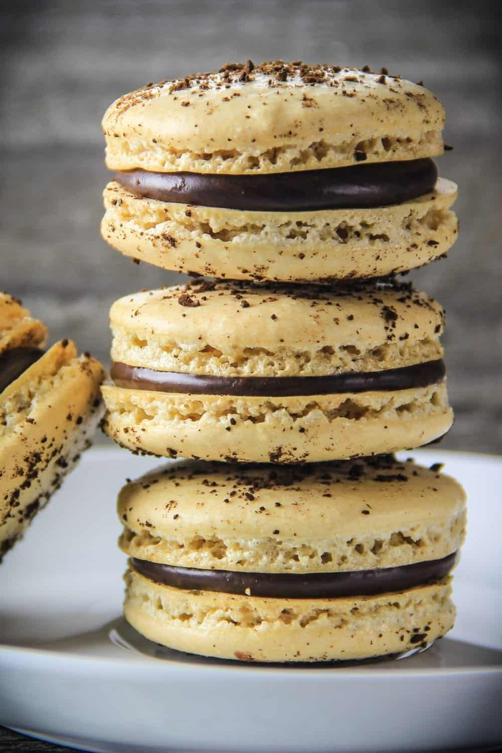coffee macarons stacked on top of each other