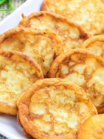 savory mashed potato pancakes on a white plate