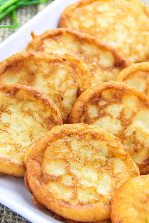 savory mashed potato pancakes on a white plate