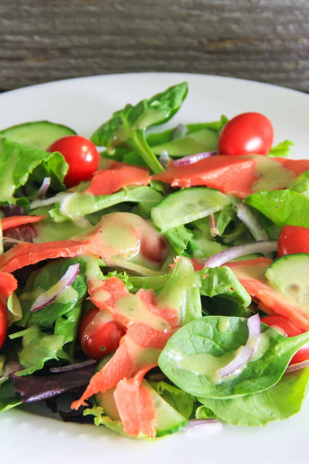 mixed baby greens with smoked salmon, cucumbers, and red onion salad