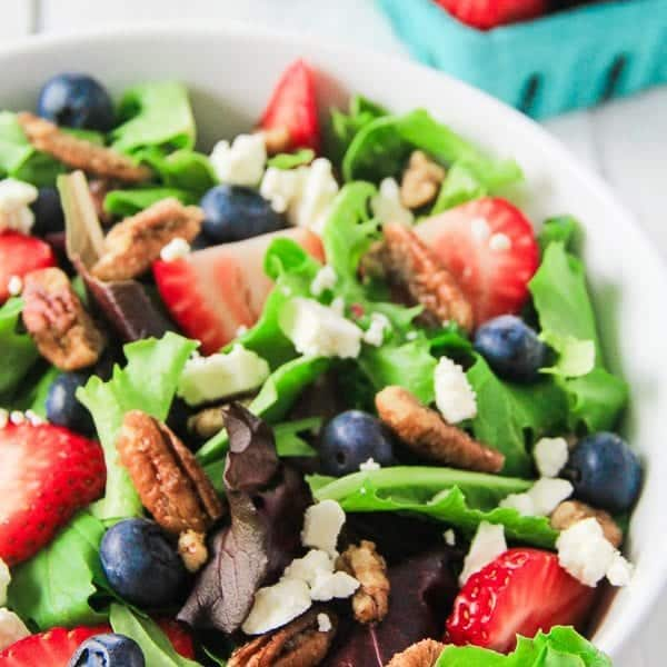 Strawberry Pecan Salad with blueberries and feta cheese in a bowl
