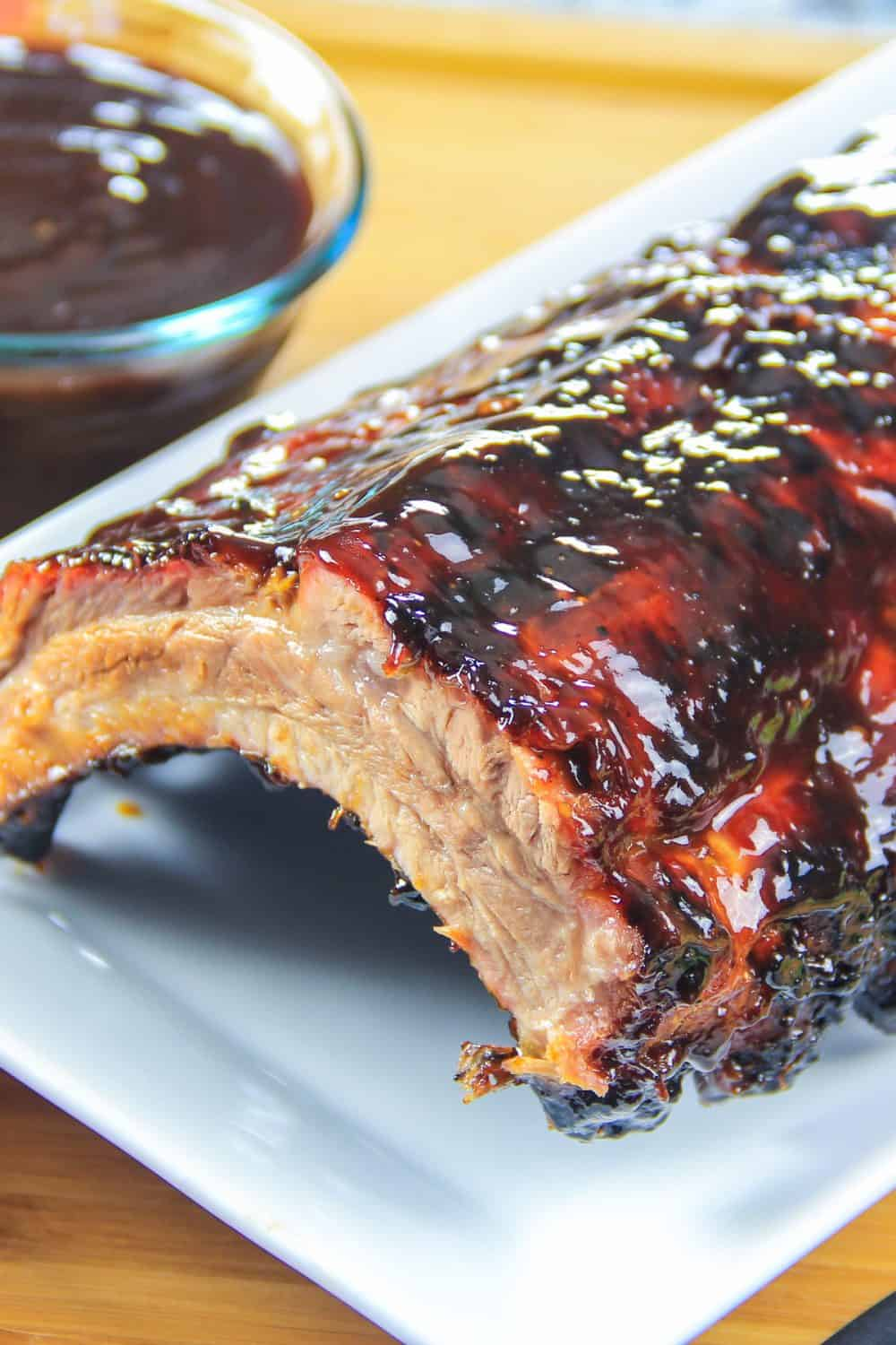 rack of barbecue ribs on a white plate