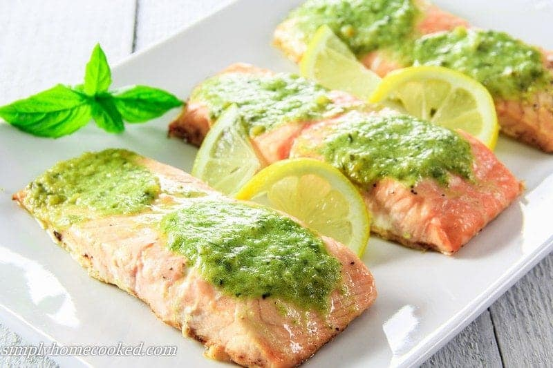 Baked salmon fillets with pesto butter on top