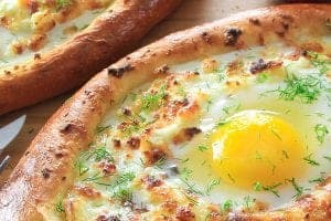 khachapuri cheese bread boat with an egg in the center