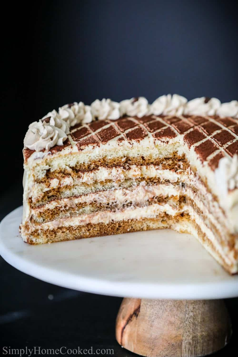 sliced tiramisu cake with cocoa powder on top