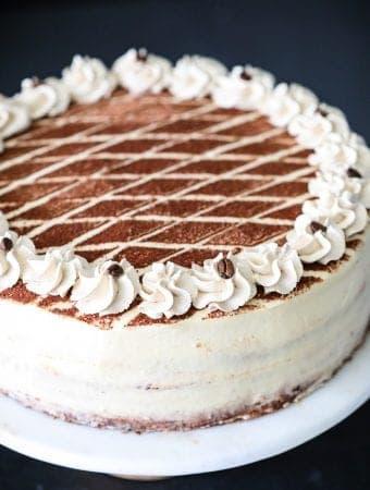 tiramisu cake with cocoa powder on top