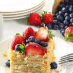 Baked puff pastry Napoleon cake with custard and berries on top