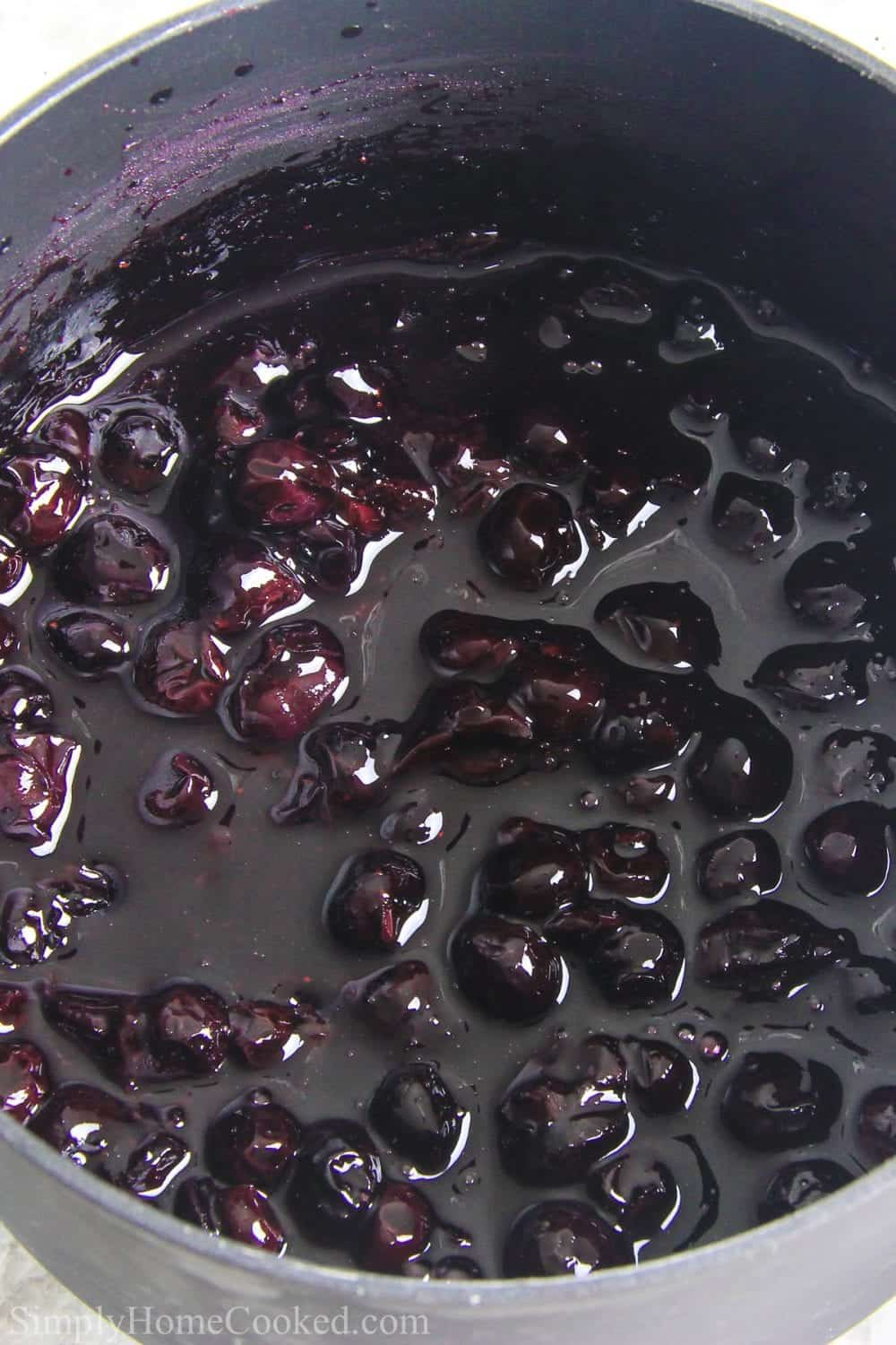 cooked blueberry pie filling in a saucepan