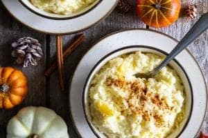 Rice pudding in a bowl with pumpkins around