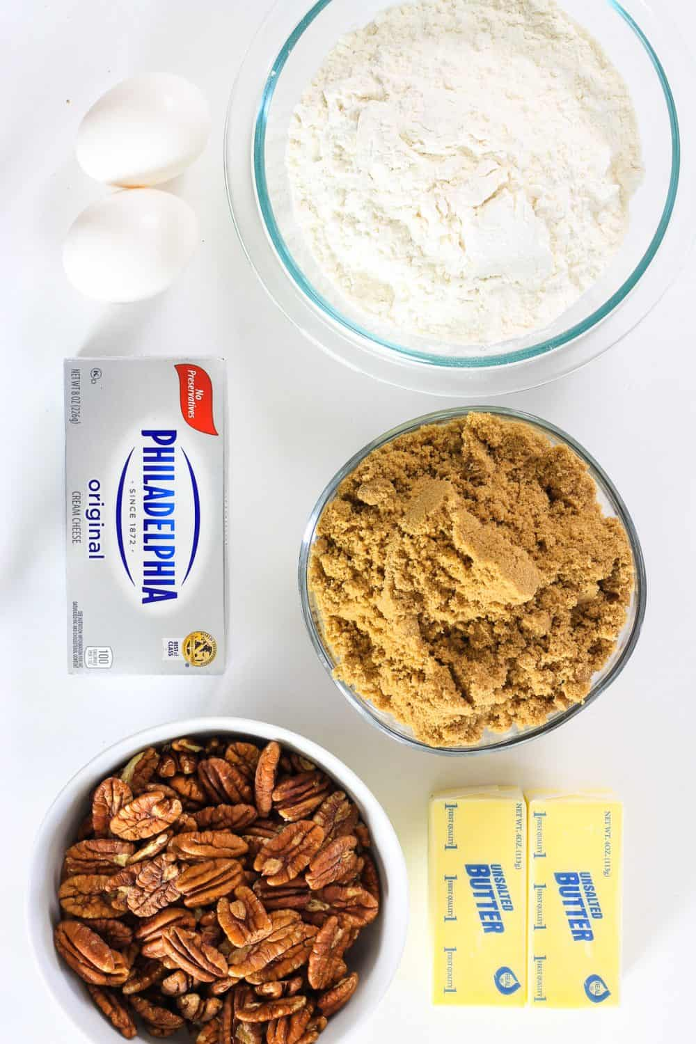 an overhead image of ingredients needed for mini pecan pies on a white background