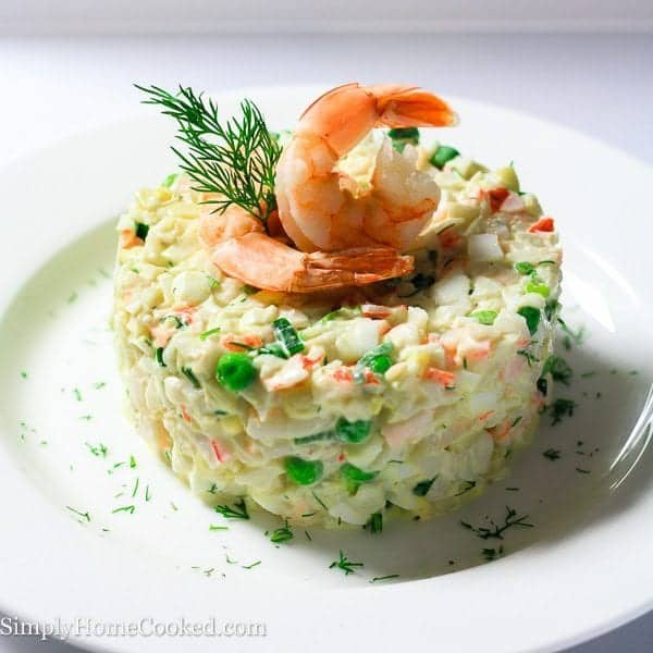 seafood salad with shrimp and dill on top