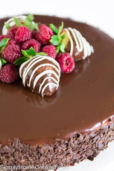 Chocolate raspberry mousse cake with fresh raspberries and chocolate covered strawberries