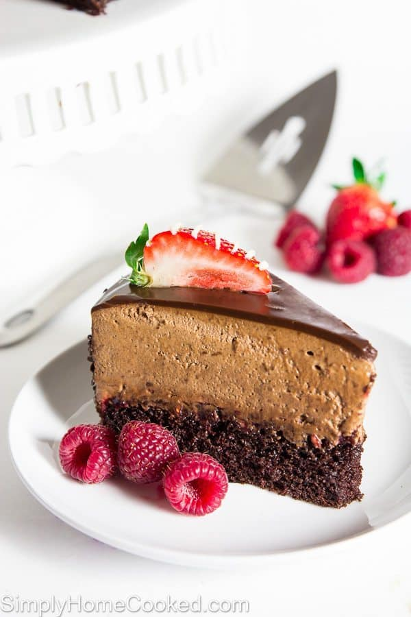 Chocolate raspberry mousse cake with fresh strawberries and raspberries
