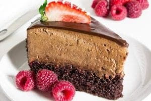 Chocolate raspberry mousse cake slice with fresh raspberries and strawberries