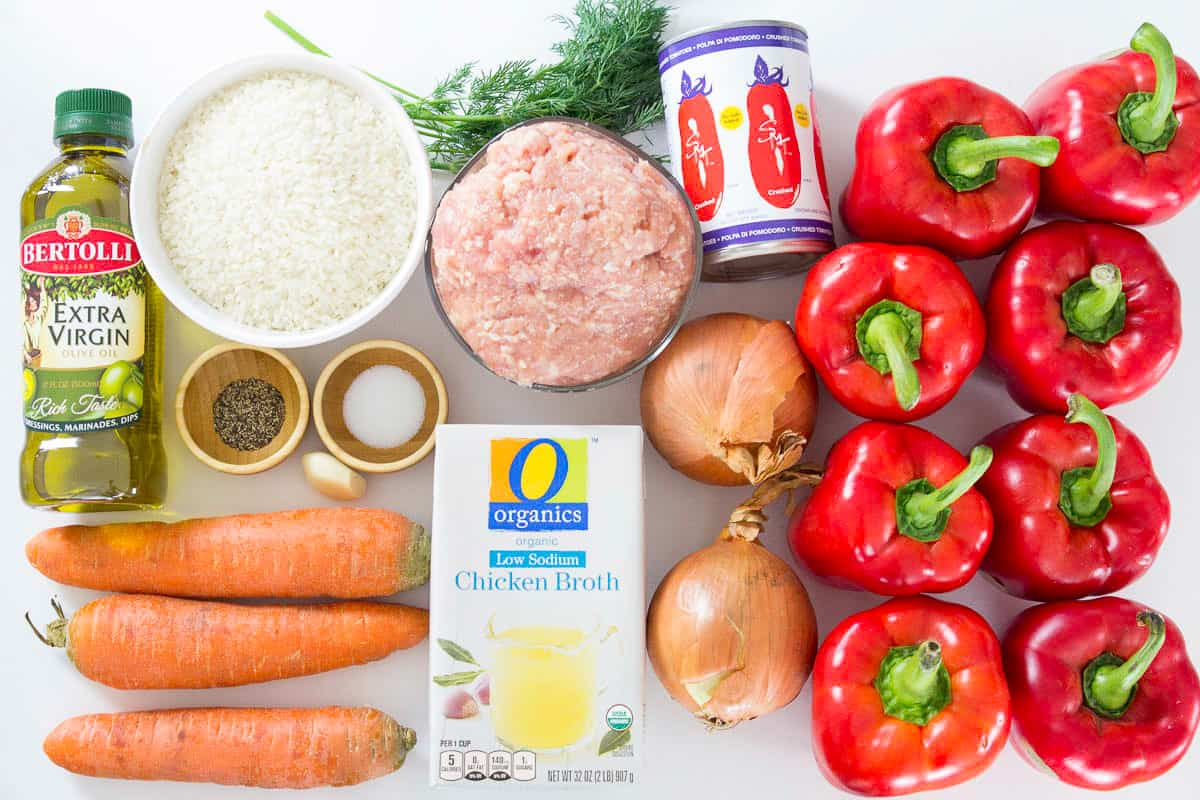 an overhead photo of ingredients needed for rice and chicken stuffed bell pepper