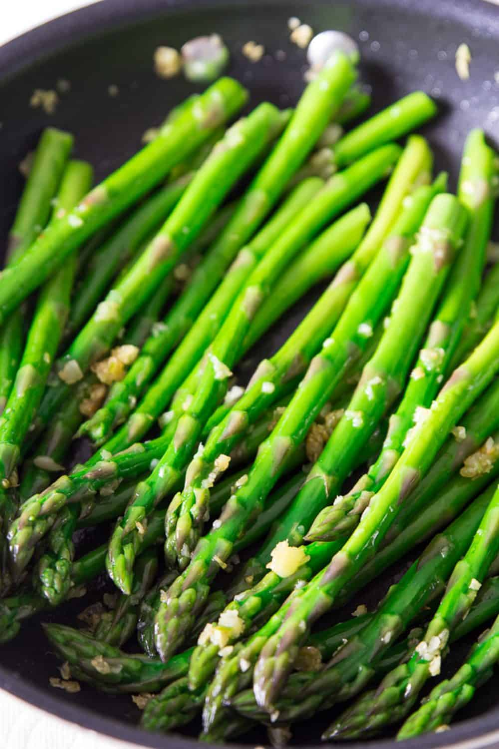 close up of garlic asparagus in a frying pan