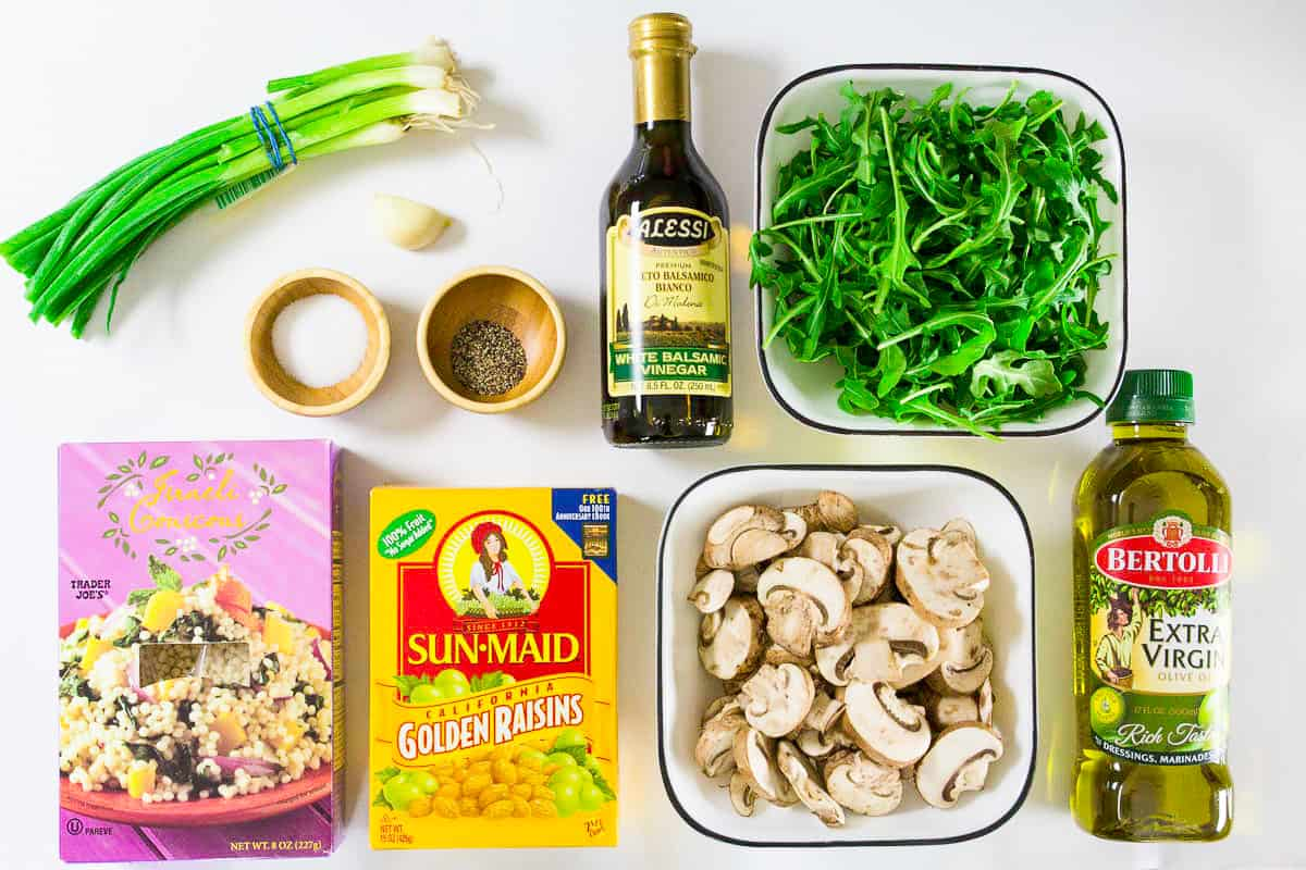 an overhead image of ingredients needed to make an easy couscous salad on a plain white background