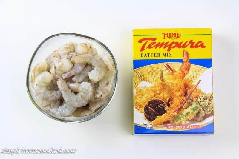 Ingredients for Shrimp tempura, including raw shrimp and a box of tempura batter mix.