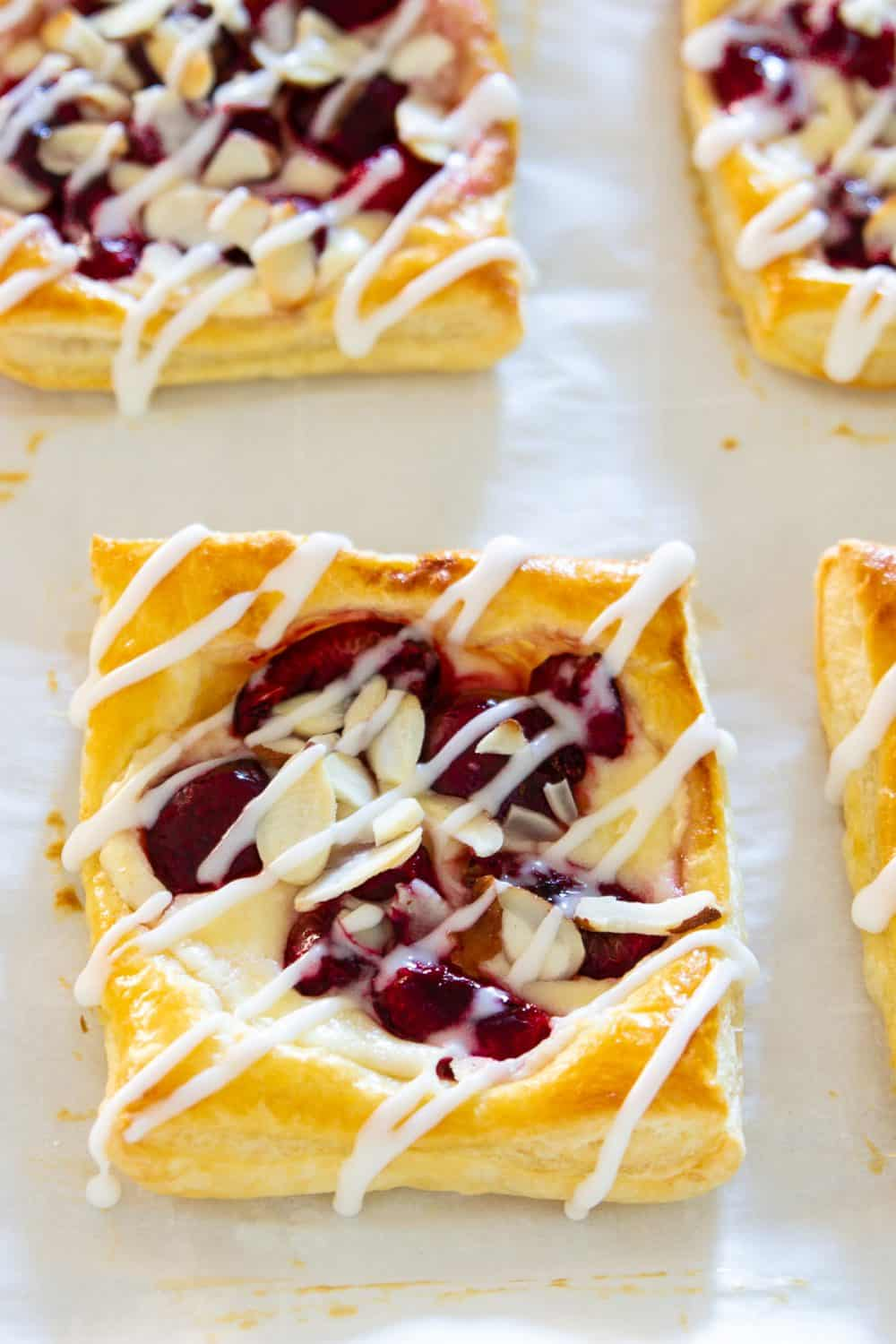 Make this beautiful cherry danish with cream cheese and almonds as a breakfast treat everyone will enjoy.