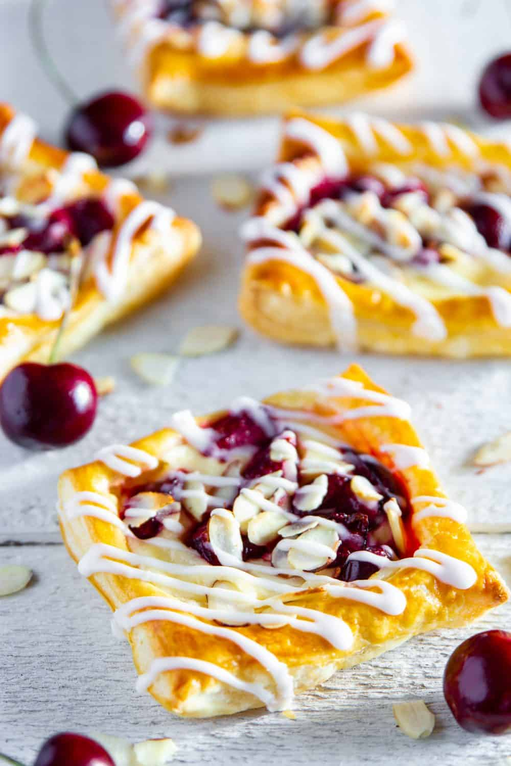 Fresh cherries alongside this puff pastry create a Cherry Danish with tons of flavor