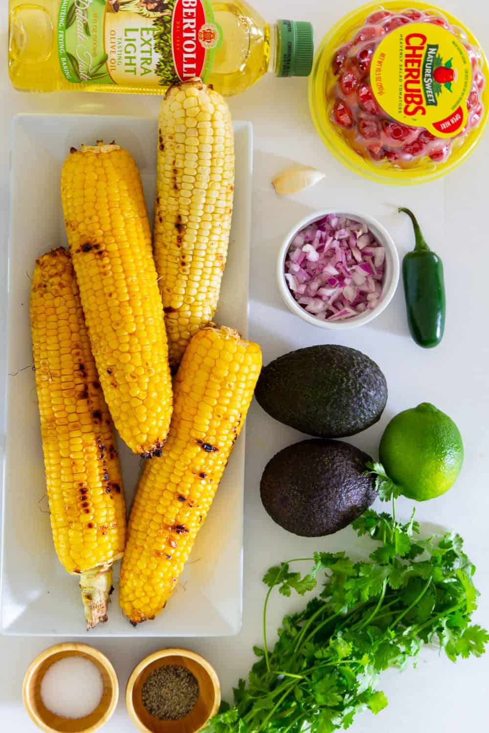 Overhead picture of ingredients for a avocado corn salad