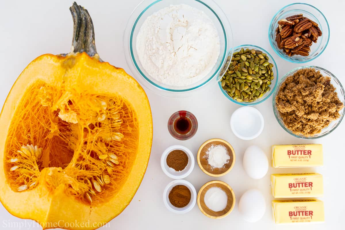 an overhead image of ingredients needed for pumpkin bread on a white background