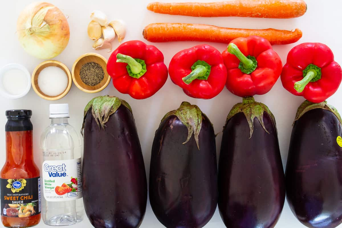 Ingredients for eggplant salad - Salt, pepper, sweet chili sauce, white vinegar, garlic, onions, red peppers, eggplants and carrots