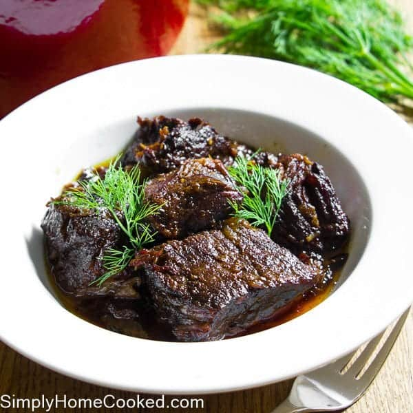 Braised Beef with fresh dill in a white bowl