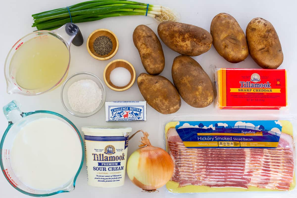 Ingredients for easy potato soup with bacon displayed on flat white surface