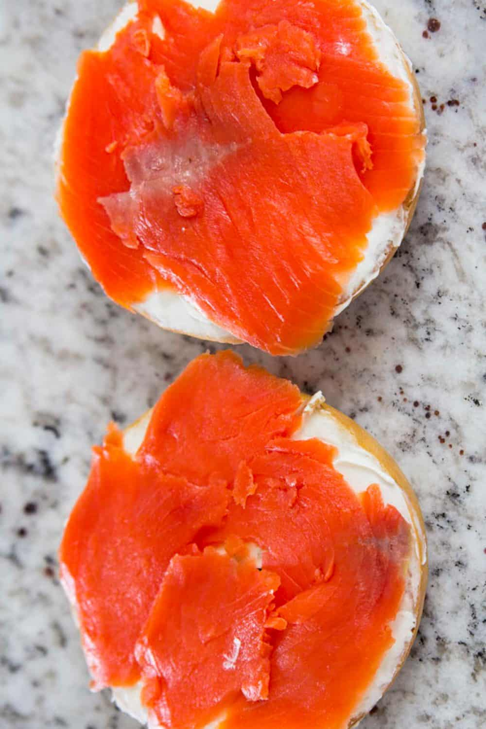 smoked lox salmon on a two toasted bagels
