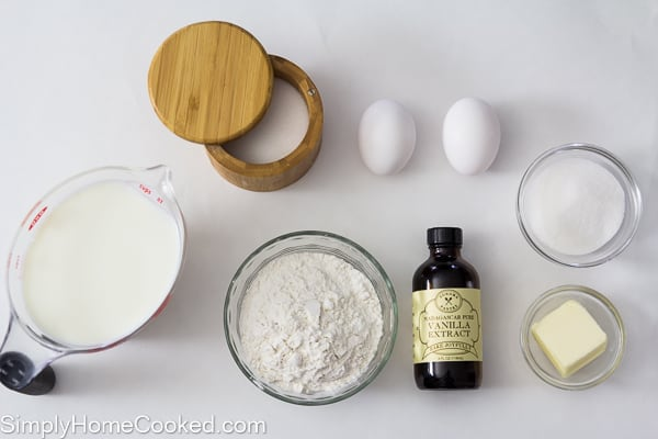 an overhead image of ingredients needed to make a dutch baby pancakes