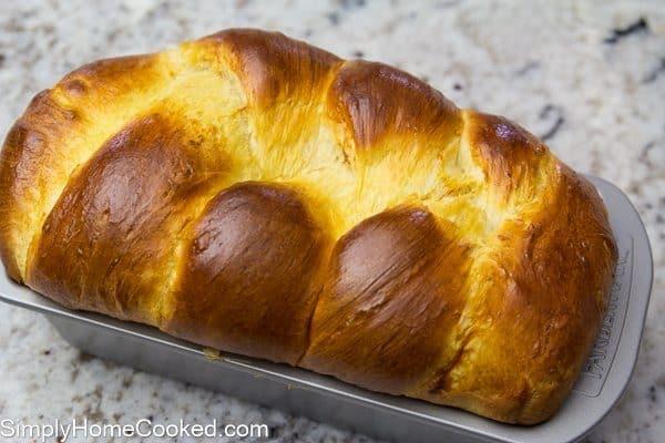 baked brioche bread in a loaf pan