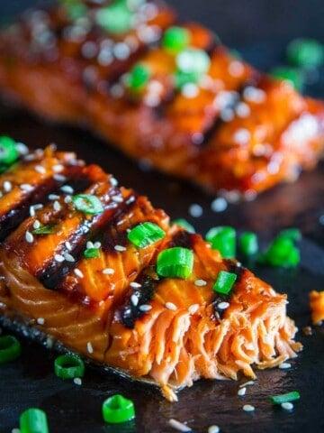 grilled teriyaki salmon with green onion and sesame seeds on top