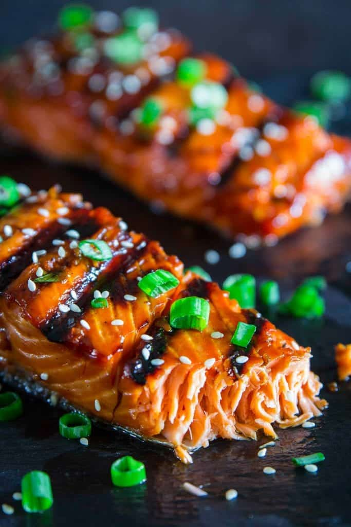 grilled teriyaki salmon with green onion and sesame seeds on top