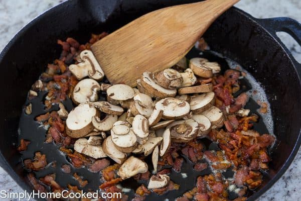 mushrooms and bacon on a cast iron skillet