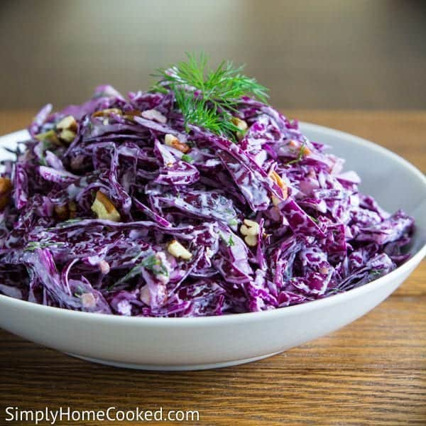 Purple Cabbage Salad in a white bowl with a little dill on top