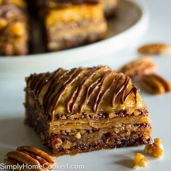 a piece of Nutella Baklava with drizzled nutella on top