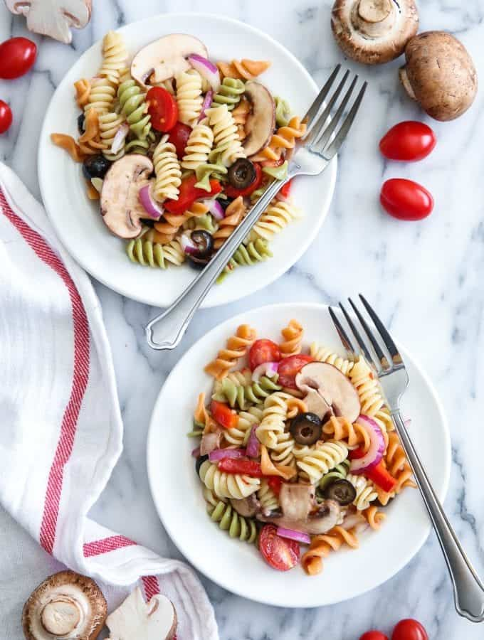 The secret to a great tri color pasta salad is to fill it with your favorite brightly colored flavorful vegetables. Add mushrooms for extra protein and flavor!