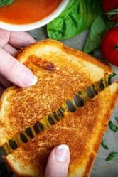 classic grilled cheese sandwich with cheese pull