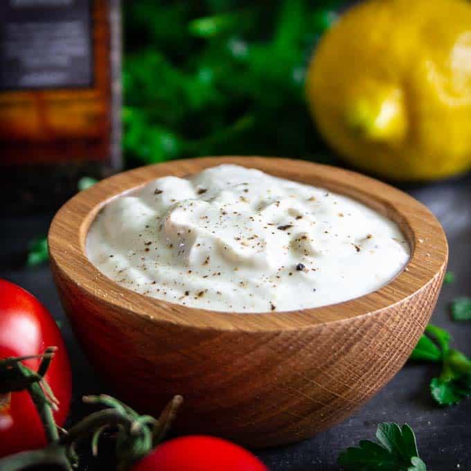 Greek yogurt sauce in a wooden bowl.