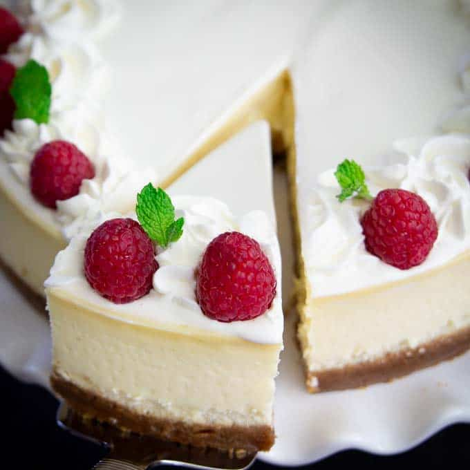white cheesecake with raspberries